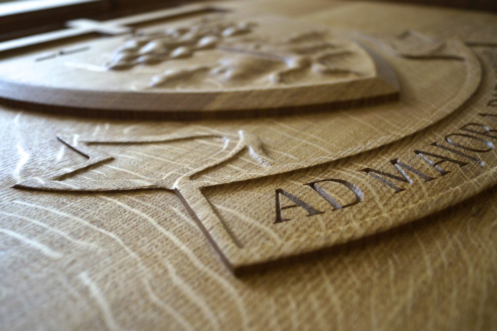 Engraved Crest in an Oak Tables from MakeMeSomethingSpecial.com